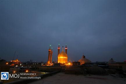 تعویض پرچم گنبد حضرت معصومه (س)