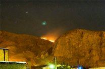 طاق بستان در میان شعله های آتش