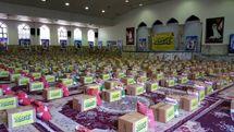 توزیع هزار بسته کمک های مومنانه کارکنان ستاد فرماندهی کل سپاه به نیازمندان