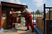 تحویل محموله سازمان برنامه جهانی غذا به هلال احمر