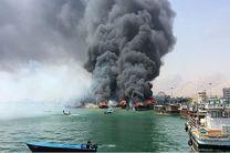 آتش سوزی در پارکینگ قایقها در بندرکلاهی میناب/۱۴ قایق صیادی طعمه حریق شد