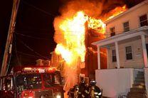 نجات زن جوان از میان دود و شعله های آتش